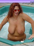 naked-playful-redhead-shows-off-her-amazing-big-and-sexy-natural-tits-in-outdoor-jacuzzi