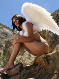 brunette-angel-traffic-stopping-in-her-beauty-seductively-poses-on-the-cliff