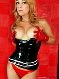latex-crazed-tranny-in-red-gloves-and-panties-takes-off-her-black-dress