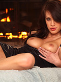 gorgeous-big-breasted-brunette-with-long-silky-hair-bares-it-all-by-the-fireplace