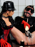 blindfolded-man-gets-his-dick-tortured-by-crazy-mistress-in-red-and-black-latex-outfit