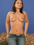 busty-brown-haired-chick-in-black-panties-removes-her-white-bra-and-blue-jeans