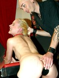 leggy-obedient-blonde-in-black-stockings-and-red-boots-gets-whipped-and-pinned