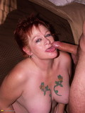 kinky-red-haired-mature-blows-fat-cock-and-gets-her-wide-pussyhole-drilled-from-behind