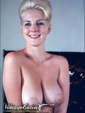 big-titted-retro-blonde-with-beautiful-irresistible-smile-poses-topless