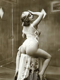 There are erotic black and white photos featuring naked vintage models