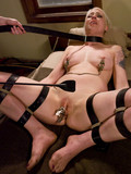lesbian-slave-blonde-gets-wildly-punished-with-clamps-strapon-whip-and-wax