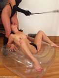 submissive-brunette-does-the-splits-after-getting-flogged-by-her-mistress