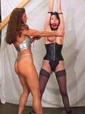 big-breasted-slave-brunette-in-nylons-and-stockings-makes-mistress-fantasies-come-true