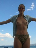wife-shows-her-smile-and-bare-tits-outdoors-while-having-a-good-time-at-the-seaside