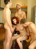 drunk-and-slutty-red-haired-wife-enjoys-unthinkable-sex-with-three-studs-at-once-in-the-kitchen