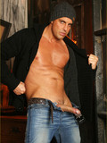 Really handsome Italian dude Marchello in tight jeans reads a paper and strokes his piston