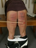 obedient-well-dressed-man-bares-his-ass-and-gets-mercilessly-caned-by-angry-woman