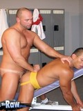 Beefy gay sportsman in yellow jocks bends over to get his ass stuffed full of cock at the gym