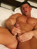 muscular-middle-aged-man-strokes-the-sperm-out-of-his-cock-in-the-morning