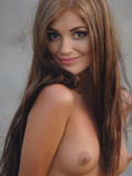 long-haired-slender-girl-with-beautiful-eyes-gets-fully-nude-in-the-middle-of-the-road